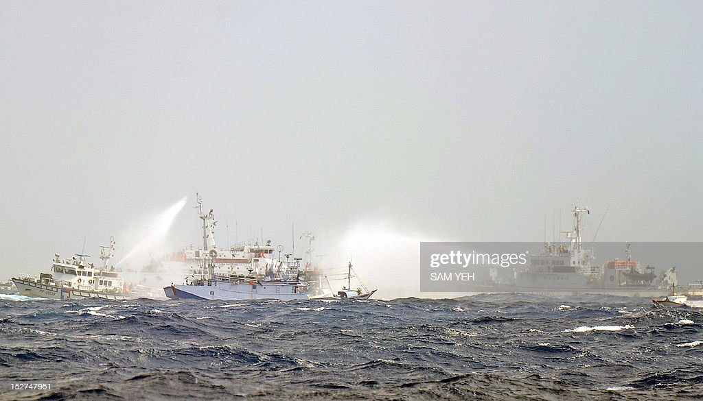 Japanese and Taiwan Coast Guard vessels use water cannon as they clash near the disputed Diaoyu / Senkaku islands in territorial waters in the East...