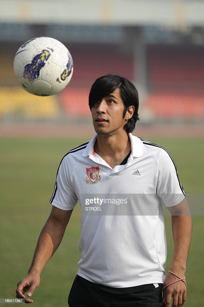 Japanese Arata Izumi looks at the ball during a performance for the press in Pune on January 31, 2013. Izumi who plays for Pune FC as a midfielder, gave up his Japanese citizenship and got his Indian passport in August, has become the first foreign national to be selected for the Indian football team. Born to an Indian father and Japanese mother, Arata had an Indian birth certificate, but he became a Japanese citizen after his parents separated.