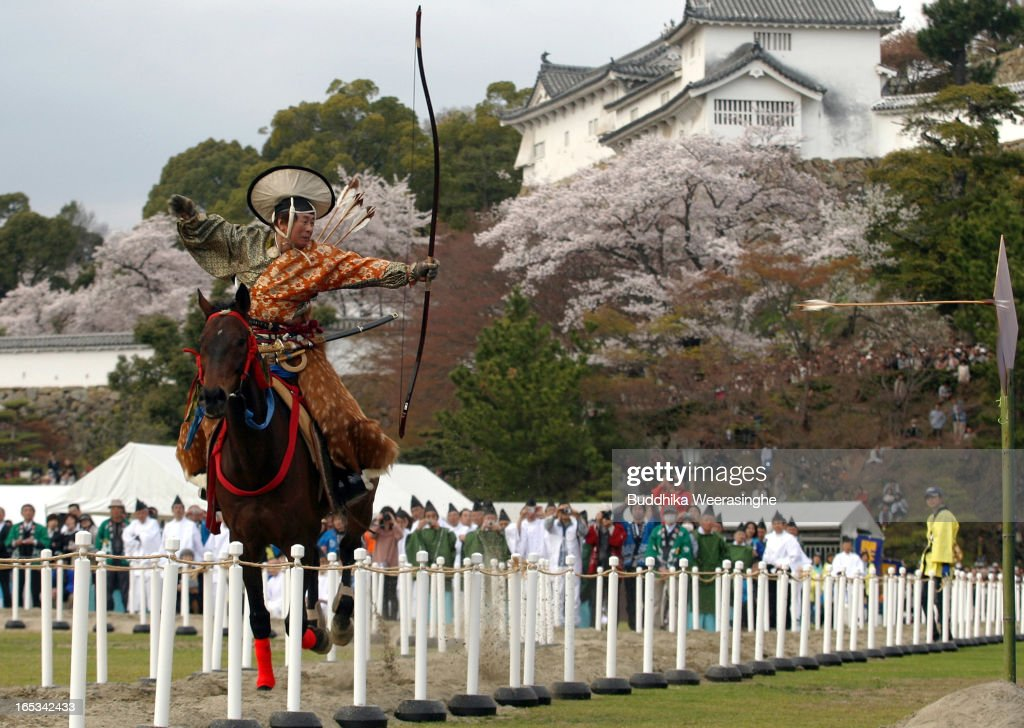 Japanese archer rides a horse while he performs traditional archery to entertain the gods during the Mitsuyama Taisai Festival of Itate Hyozu Shrine on April 3, 2013 in Himeji, Japan. The festival has been held once every 20 years since 1593. Priests of Itate Hyozu Shrine welcome all the gods across the country on the night of March 31st from the top of the 'three mountains' and treat with food for seven days to April 7 praying for peace and prosperity.