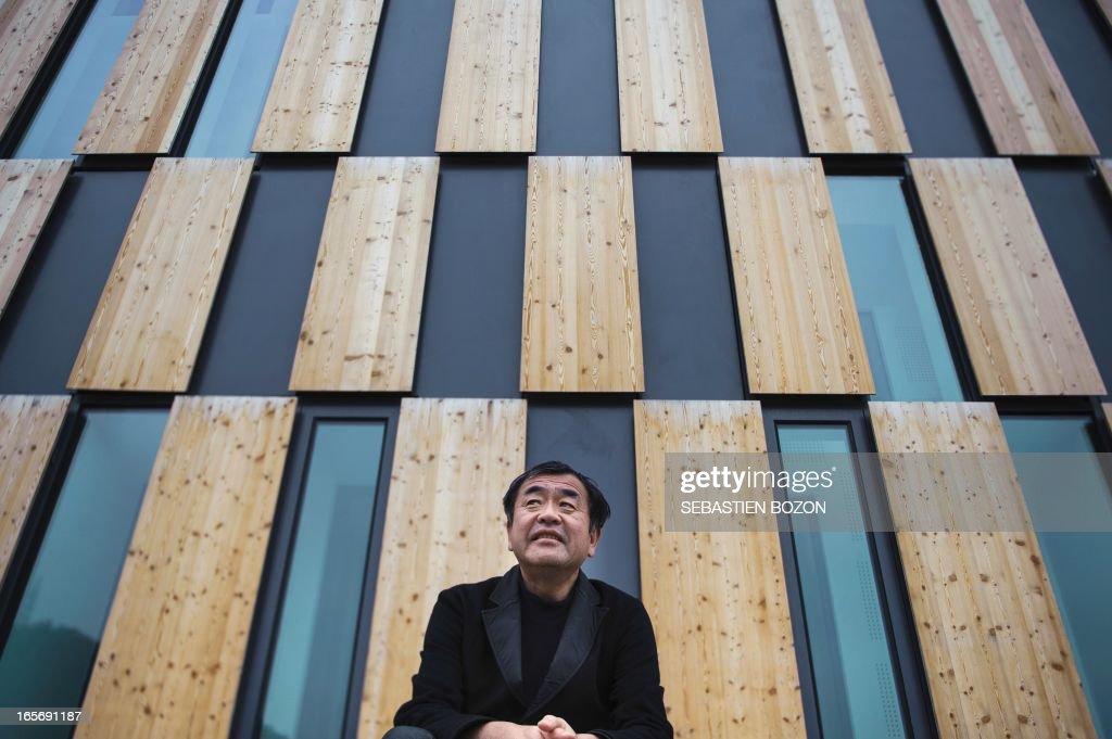 Japanese architect Kengo Kuma psoes in front of his new building in Besancon 'La Cité des Arts' on April 5, 2013.