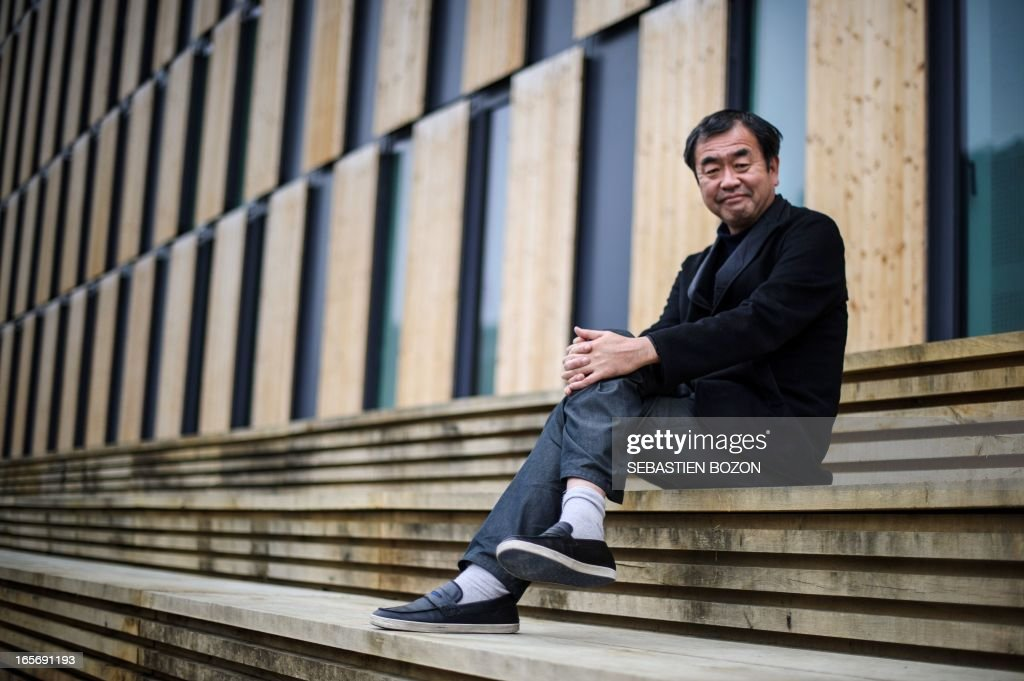 Japanese architect Kengo Kuma psoes near his new building in Besancon 'La Cité des Arts' on April 5, 2013. AFP PHOTO / SEBASTIEN BOZON