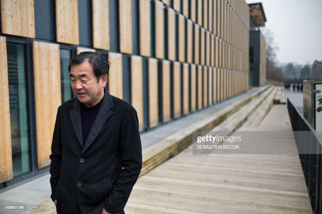 Japanese architect Kengo Kuma psoes near his new building in Besancon 'La Cité des Arts' on April 5, 2013.