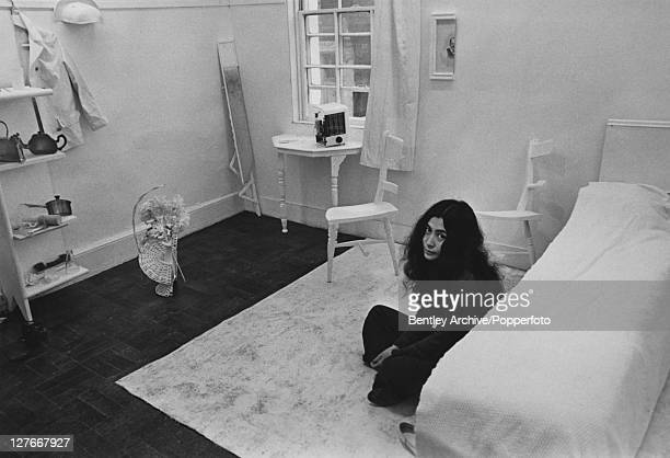 Japanese artist and musician Yoko Ono sits in a whitepainted half bedroom entitled 'HalfaRoom' part of her avantgarde HalfaMemory exhibition on show...