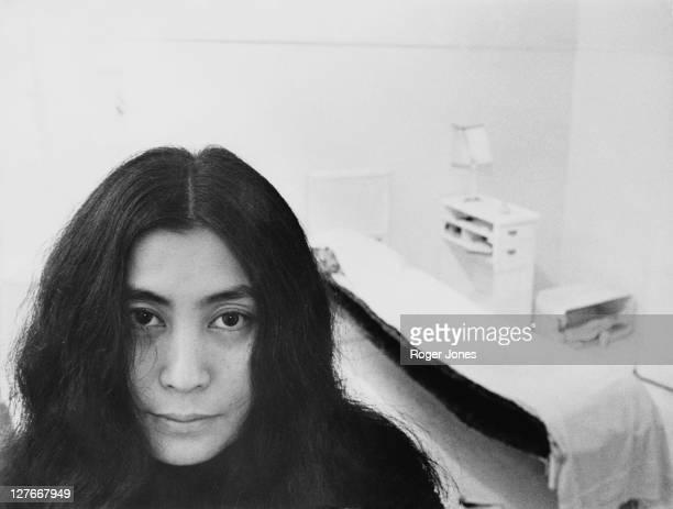 Japanese artist and musician Yoko Ono sits in a whitepainted half bedroom entitled 'HalfaRoom' part of her recent avantgarde HalfaMemory exhibition...