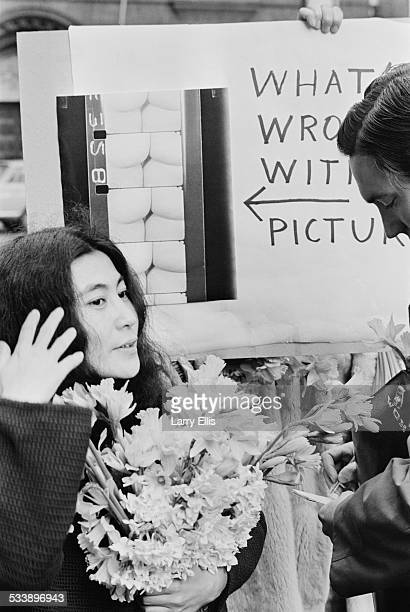 Japanese artist and musician Yoko Ono talking to a reporter at a protest outside the offices of the British Board of Film Censors London 10th March...