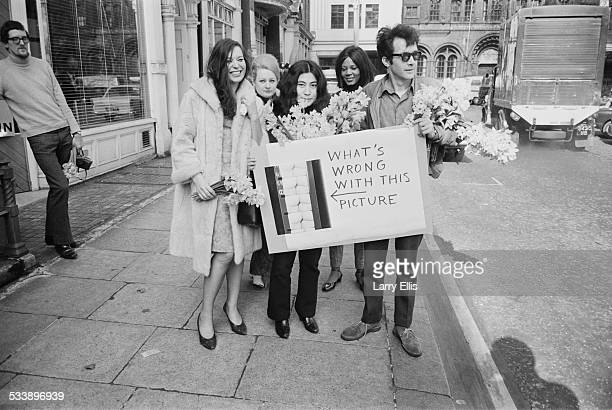 Japanese artist and musician Yoko Ono with her second husband American film producer and art promoter Anthony Cox at a protest outside the offices of...