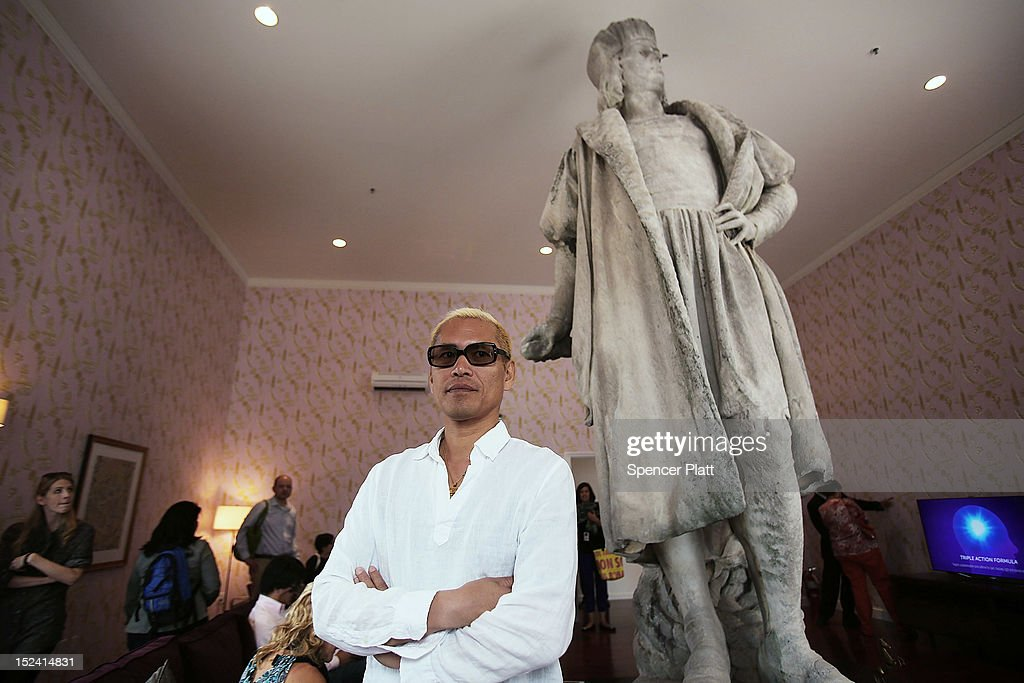 Japanese Artist Tatzu Nishi Stands Beside The 13 Foot Statue Of Christopher Columbus In His