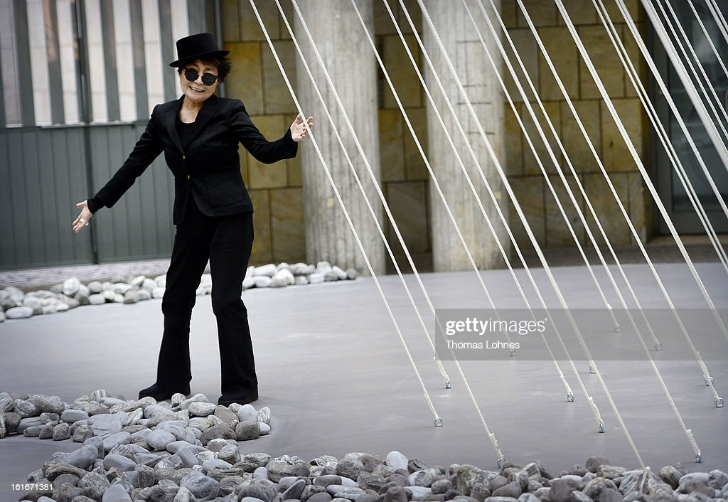Japanese artist <a gi-track='captionPersonalityLinkClicked' href=/galleries/search?phrase=Yoko+Ono&family=editorial&specificpeople=202054 ng-click='$event.stopPropagation()'>Yoko Ono</a> poses alongside her artwork 'Morning Beams' and 'River Bed' at the Schirn Kunsthalle on February 14, 2013 in Frankfurt am Main, Germany. In honor of Ono's 80th birthday, who was born in Tokyo on February 18, 1933, the Schirn Kunsthalle Frankfurt is presenting an extensive retrospective from February 15 until May 12, 2013 encompassing a representative selection of her works from over the past 60 years.