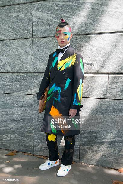 Japanese artist Yoshi Itsu wears personally customized Louis Vuitton coat bag and trousers on day 2 of Paris Collections Men on June 25 2015 in Paris...