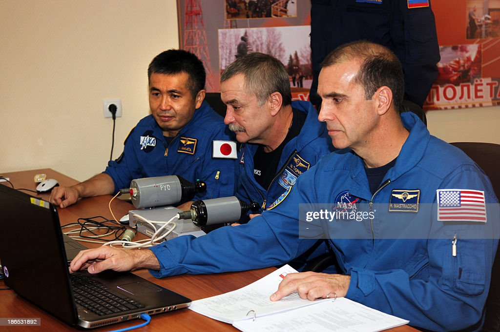 Japanese astronaut Koichi Wakata, Russian cosmonaut Mikhail Tyurin and US astronaut Rick Mastracchio attend their preflight training in the Russian leased Kazakhstan's Baikonur cosmodrome on November 1, 2013. The three-man crew is scheduled to blast off to the International Space Station (ISS) from Baikonur on November 7.