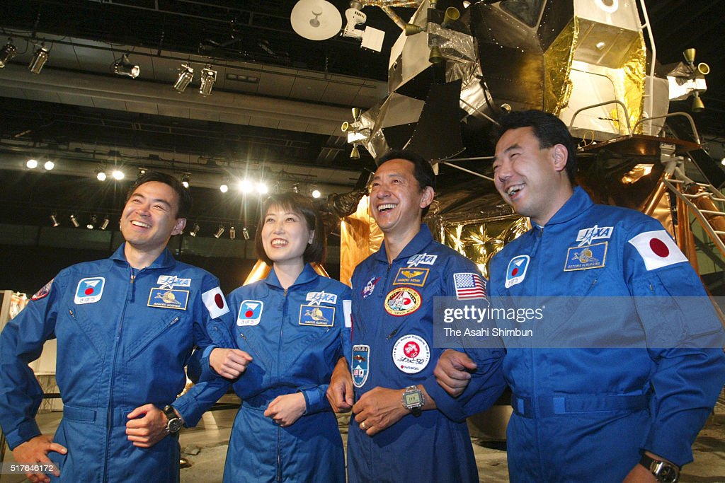Japanese astronauts Akihiko Hishide, Naoko Yamazaki, Mamori Mohri and <a gi-track='captionPersonalityLinkClicked' href=/galleries/search?phrase=Satoshi+Furukawa&family=editorial&specificpeople=4955533 ng-click='$event.stopPropagation()'>Satoshi Furukawa</a> pose for photographs at the Miraikan, The National Museum of Emerging Science and Innovation on October 1, 2003 in Tokyo, Japan.