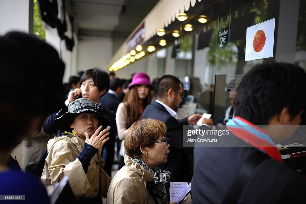 Japanese at the betting windows at Longchamp racecourse on October 06, 2013 in Paris, France.
