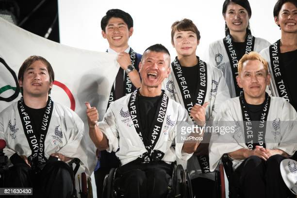 Japanese athletes posses for photos during the Tokyo 2020 flag tour festival for the 2020 Games at Tokyo Metropolitan Plaza in Tokyo July 24 2017...