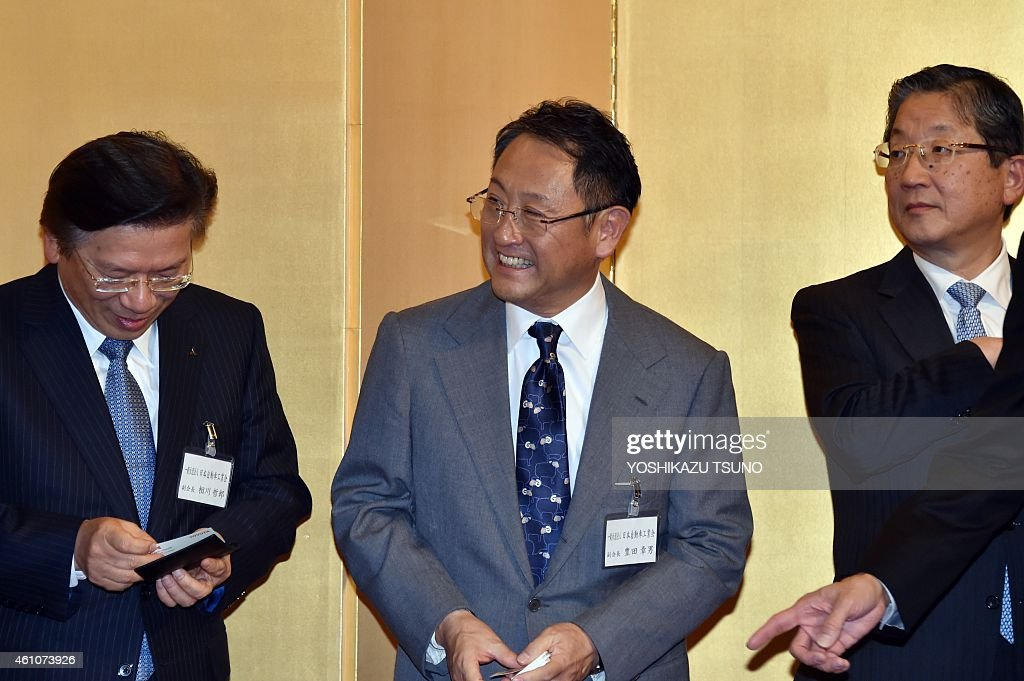 Japanese auto giant Toyota Motor president Akio Toyoda smiles with Nissan Motor vice chairman Toshiyuki Shiga and Mitsubishi Motors president Tetsuro...