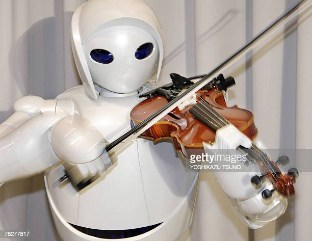 Japanese auto giant Toyota Motor unveils their new violinplaying robot at the company's showroom in Tokyo 06 December 2007 Toyota unveiled three...