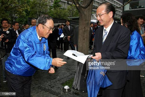 Japanese Automaker And Oil Company Executives' Street Protest In Downtown Tokyo Japan On May 11 2006 Toyota Motor Co Vice Chairman Fujio Cho passes...