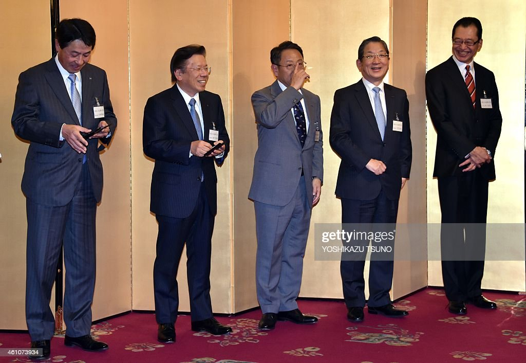 Japanese automaker leaders (L-R) Mazda Motor president <a gi-track='captionPersonalityLinkClicked' href=/galleries/search?phrase=Masamichi+Kogai&family=editorial&specificpeople=10904432 ng-click='$event.stopPropagation()'>Masamichi Kogai</a>, Mitsubishi Motors president <a gi-track='captionPersonalityLinkClicked' href=/galleries/search?phrase=Tetsuro+Aikawa&family=editorial&specificpeople=2455880 ng-click='$event.stopPropagation()'>Tetsuro Aikawa</a>, Toyota Motor president <a gi-track='captionPersonalityLinkClicked' href=/galleries/search?phrase=Akio+Toyoda&family=editorial&specificpeople=2334399 ng-click='$event.stopPropagation()'>Akio Toyoda</a>, Nissan Motor vice chairman <a gi-track='captionPersonalityLinkClicked' href=/galleries/search?phrase=Toshiyuki+Shiga&family=editorial&specificpeople=599368 ng-click='$event.stopPropagation()'>Toshiyuki Shiga</a> and Honda Motor chairman Fumihiko Ike share smiles at a new year party hosted by the auto industry association in Tokyo on January 6, 2015. Toyota marked a record-high auto sales of over million vehicles in China last year, while they missed target sales of 1.1 million units. AFP PHOTO / Yoshikazu TSUNO