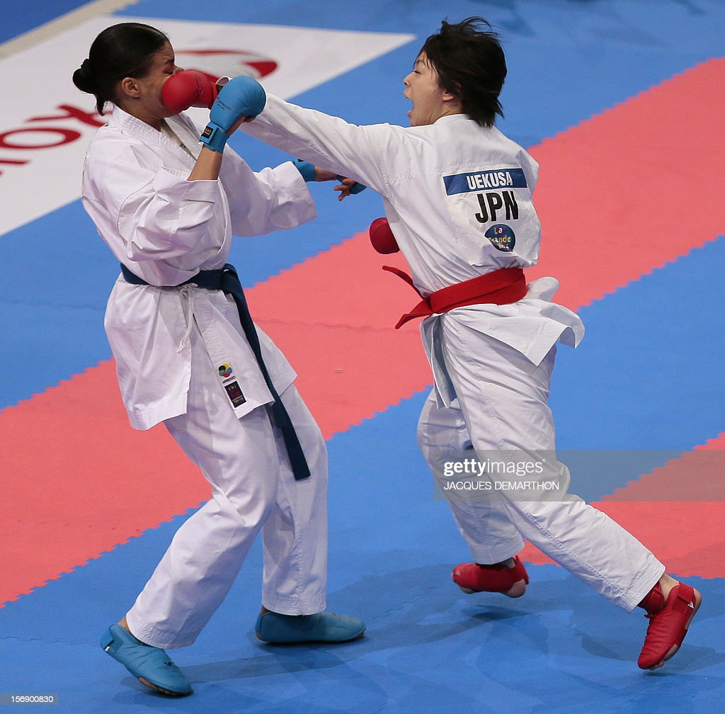 Japanese Ayumi Uekusa (R) fights against Switzerland Jessica Cargill (L) during their women's bronze medal bout in the over 68 kg category at the Karate world championships on November 24, 2012 in Paris. Ayumi Uekusa won the bout.