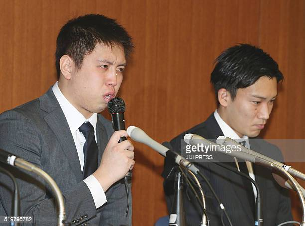 Japanese badminton player Kenichi Tago answers a question beside Kento Momota during their press conference in Tokyo on April 8 2016 Momota made a...