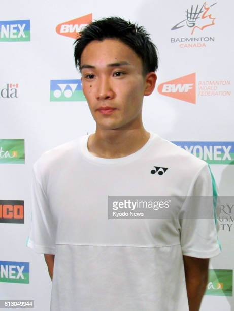 Japanese badminton player Kento Momota speaks to reporters after winning his firstround match at the Canada Open in Calgary on July 11 2017 The...