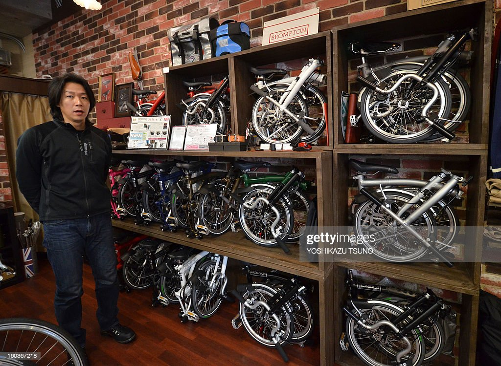 Japanese bicycle shop manager Seiji Hirata displays Brompton folding bicycles at his shop 'Green Cycle Station' in Yokohama, in Japan, on January 27, 2013. British bicycle company Brompton produced 36,000 bikes in 2012 with a turnover of around GBP 20m (approx 23.25m euros). Brompton's folding bikes have proved popular with customers in Asian countries such as Japan. AFP PHOTO / Yoshikazu TSUNO