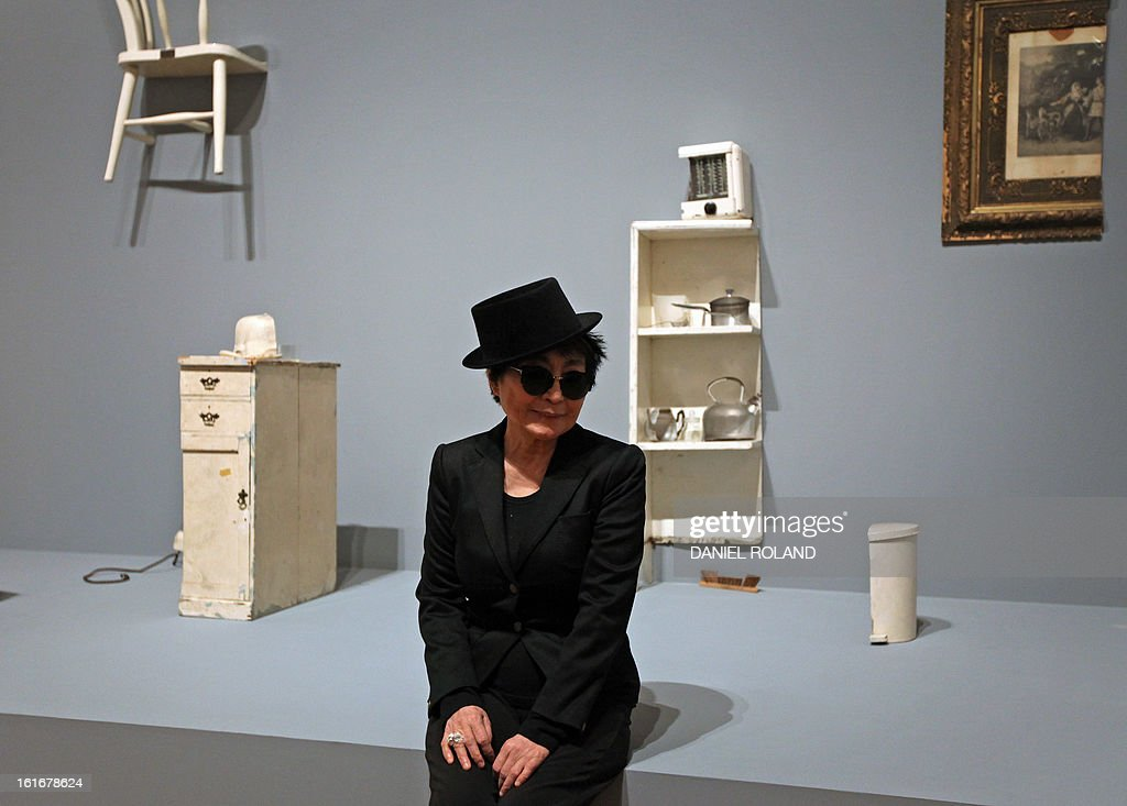 Japanese born artist Yoko Ono poses in front of her installation 'half a room' during the press visit of her exhibition 'Half-a-wind show A retrospective' at the Schirn Kunsthalle in Frankfurt am Main, central Germany, February 14, 2013. The exhibition runs from February 15 till May 12, 2013.