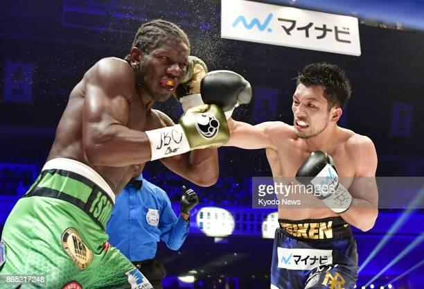 Japanese boxer Ryota Murata slugs Hassan N'Dam of France in a WBA middleweight title fight at Ryogoku Kokugikan in Tokyo on Oct 22 2017 ==Kyodo