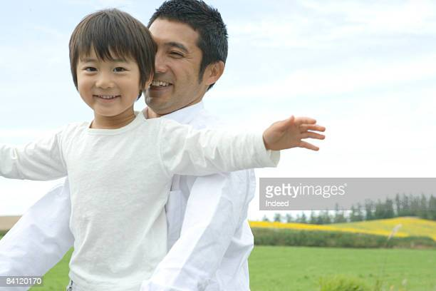 Japanese boy and father riding bicycle together