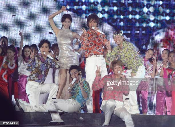 Japanese boy banad SMAP and Taiwanese model Chiling Lin perform on the stage at Beijing Concert at Beijing Workers Stadium on September 16 2011 in...
