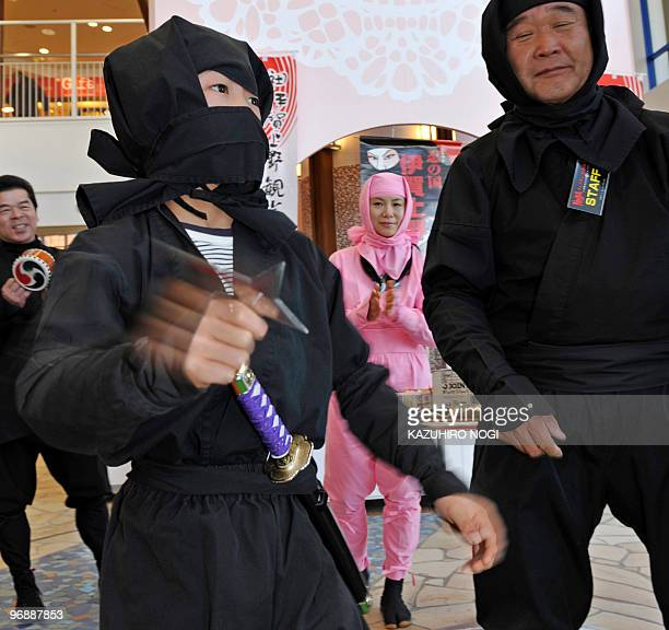 A Japanese boy dressed as a ninja throws a shuriken a traditional Japanese concealed weapon during a ninja festival at a Tokyo amusement park on...