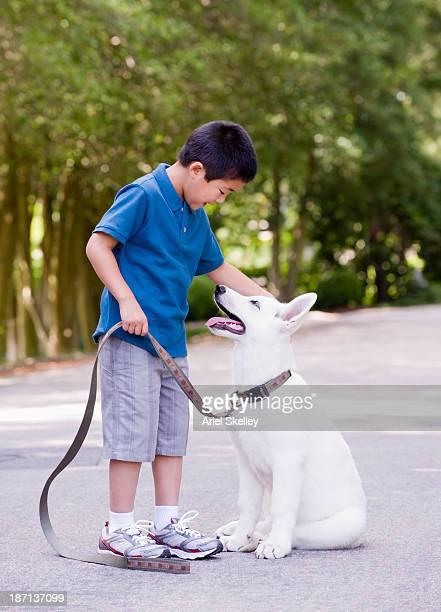 Japanese boy holding dog's leash