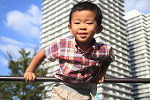Japanese boy playing with high bar (4 years old)