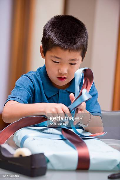 Japanese boy wrapping birthday present