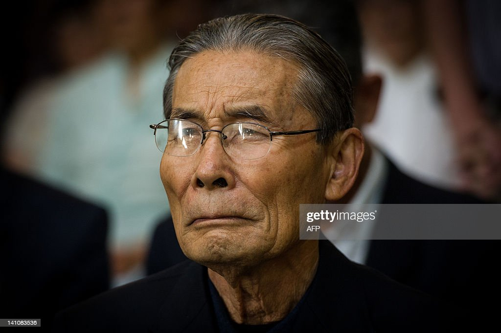 A Japanese Brazilian man attends the mass on the day before of the first anniversary of the earthquake-tsunami disaster in Japan at Sao Goncalo Church in Sao Paulo, Brazil on March 10, 2012. The church locates next to Liberdade area where many Japanese immigrants and descendants live. The disaster happened in the Northeast of Japan and left more than 19,000 people dead or missing. AFP PHOTO/Yasuyoshi Chiba