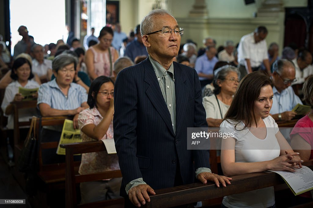 A Japanese Brazilian man keeps standing during the mass on the day before of the first anniversary of the earthquake-tsunami disaster in Japan at Sao Goncalo Church in Sao Paulo, Brazil on March 10, 2012. The church locates next to Liberdade area where many Japanese immigrants and descendants live. The disaster happened in the Northeast of Japan and left more than 19,000 people dead or missing. AFP PHOTO/Yasuyoshi Chiba