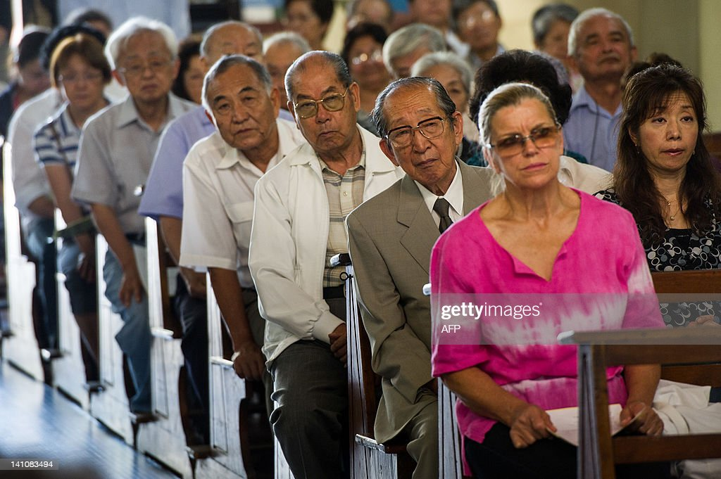 Japanese Brazilians attend a mass on the day before of the first anniversary of the earthquake-tsunami disaster in Japan at Sao Goncalo Church in Sao Paulo, Brazil on March 10, 2012. The church locates next to Liberdade area where many Japanese immigrants and descendants live. The disaster happened in the Northeast of Japan and left more than 19,000 people dead or missing. AFP PHOTO/Yasuyoshi Chiba