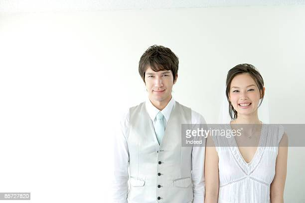 Japanese bride and groom smiling, portrait