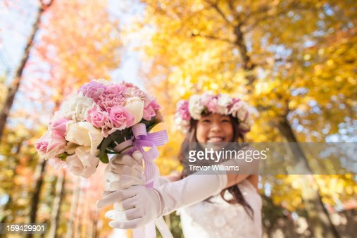A Japanese bride in a wedding dress showing ehr bo : Stock Photo