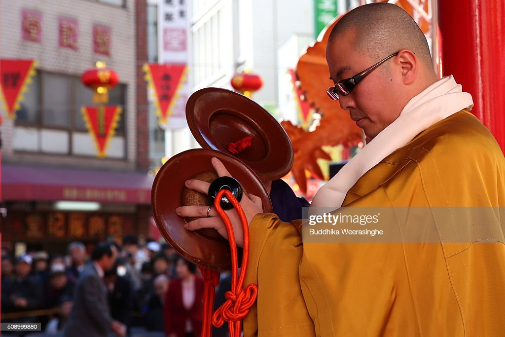 A Japanese Buddhist monk performs a religious ritual to celebrate the Chinese New Year on a stage at the Nankinmachi square, China Town on February 8, 2016 in Kobe, Japan. In Nankinmachi, the district known as Kobe Chinatown, tourists enjoyed Chinese food, lion dance and the parade organized to celebrate the Lunar New Year.