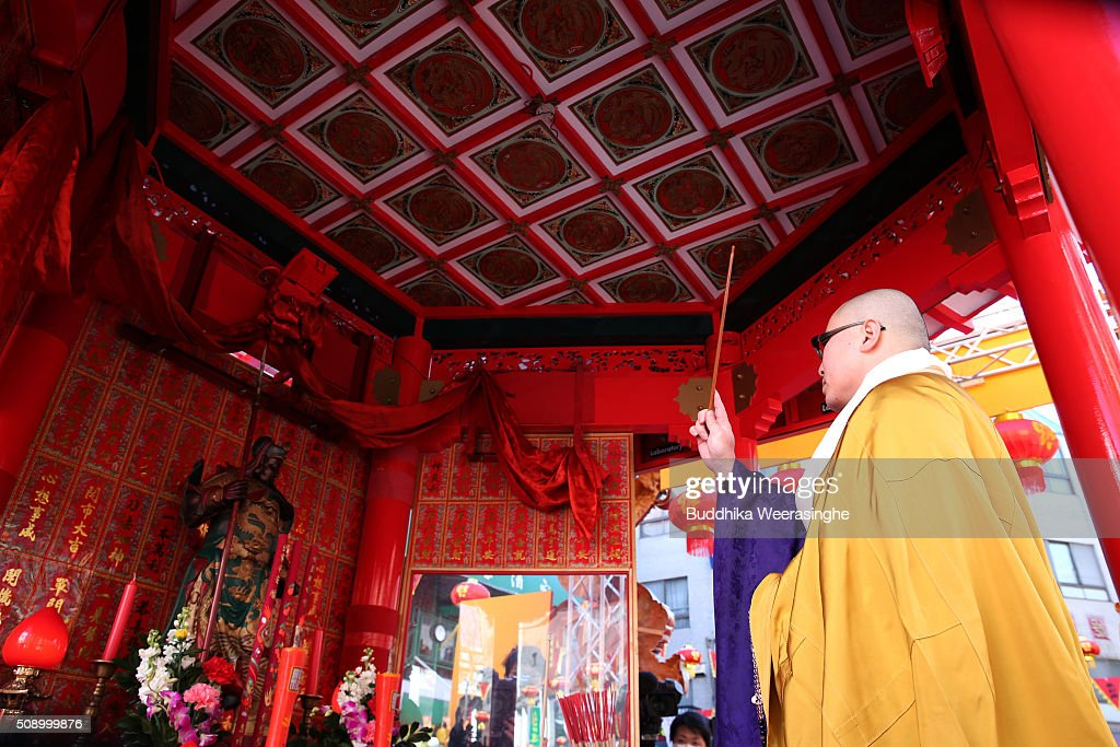 A Japanese Buddhist monk performs religious ritual to celebrate the Chinese New Year on a stage at the Nankinmachi square, China Town on February 8, 2016 in Kobe, Japan. In Nankinmachi, the district known as Kobe Chinatown, tourists enjoyed Chinese food, lion dance and the parade organized to celebrate the Lunar New Year.