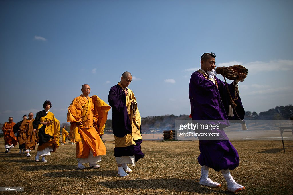 Japanese Buddhist monks chant and pay their respects to victims from the tsunami and earthquake during the second anniversary commemoration on March 10, 2013 in Minamisoma, Japan. Japan on March 11 will commemorate the second anniversary of the magnitude 9.0 earthquake and following tsunami, that claimed more than 18,000 lives.