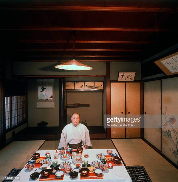 A Japanese business man in kimono sitting in front of a laid low table Kyoto 1960s