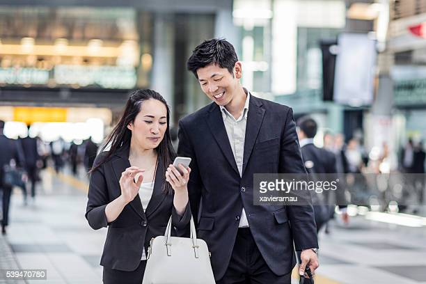 Japanese business people commuting to work at the station
