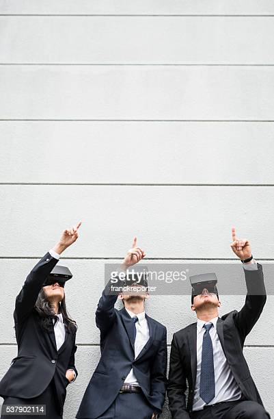 japanese business persons using the VR simulator on the city