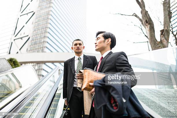 japanese Business walking together on the downtown