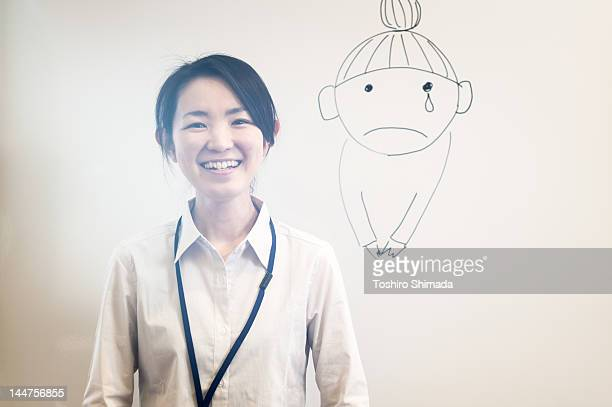 Japanese business woman against white board