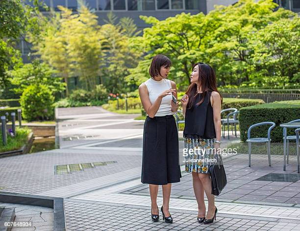 Japanese business women talking in gardens