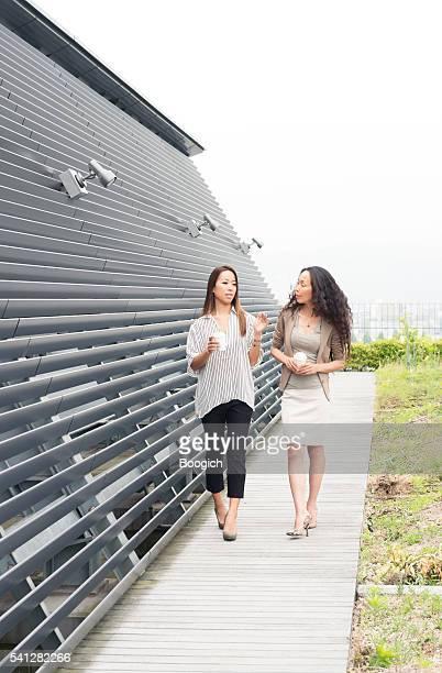 Japanese Business Women Walking and Talking Outdoors Kyoto Japan