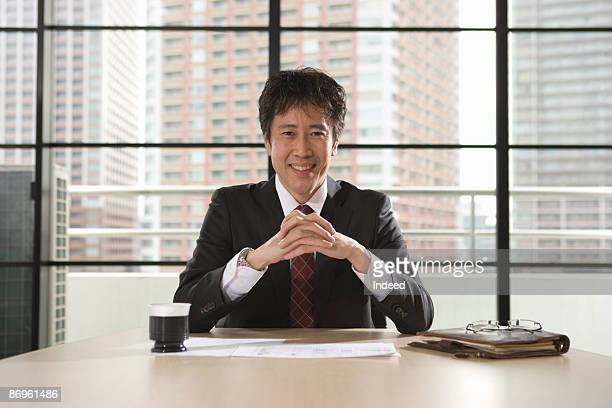Japanese businessman in office, portrait