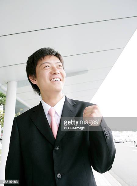 Japanese businessman walking outside of airport